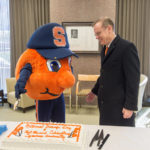 Philanthropy Week 2015 Fast Forward Syracuse Presentation of Winning Projects. Chancellor Syverud and Otto Cutting Cake